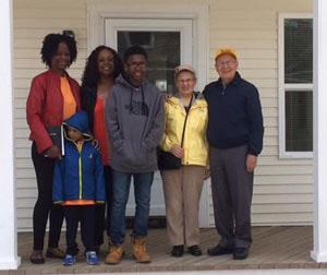 Robinson family with Otto & Sheila Muller-Girard on front porch