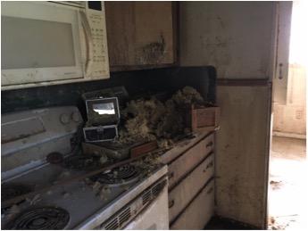 Debris strew kitchen counters
