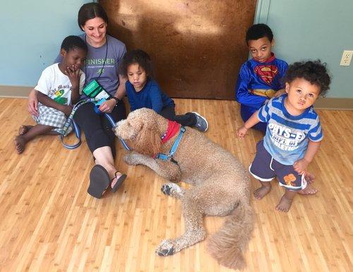 4 children with dog on kitchen floor